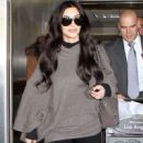Kim Kardashian & friend arriving on a flight at LAX airport January 24, 2011