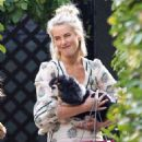 Julianne Hough give her pup some cuddles in Los Angeles