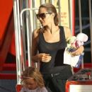 Angelina Jolie with her adorable twins Vivienne and Knox for a thrilling ride at Luna Park in Sydney (January 6, 2014)