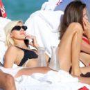Devon Windsor in Black Bikini at the beach in Miami