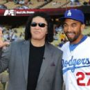 Matt Kemp poses with musician Gene Simmons at the Dodgers v Ny Mets game where he threw to out the first pitch of the game at Dodger Stadium on July 5, 2011 in Los Angeles, California.