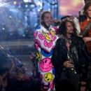 Aerosmith and Post Malone perform onstage during the 2018 MTV Video Music Awards at Radio City Music Hall on August 20, 2018 in New York City - 454 x 302