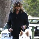 Billy Ray Cyrus takes his dogs out for a relaxing stroll through his neighborhood in Toluca Lake, California on April 4, 2014 - 444 x 594