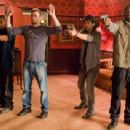 L-r: COLUMBUS SHORT as Pooch, CHRIS EVANS as Jensen, OSCAR JAENADA as Cougar and IDRIS ELBA as Roque in Warner Bros. Pictures' and Dark Castle Entertainment's action thriller 'The Losers,' released by Warner Bros. Pictures. TM & © DC Comic - 454 x 342