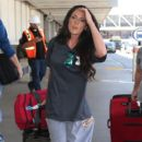 Jenelle Evans Is departing a flight out of Los Angeles International Airport (LAX) Monday, August 31,2015 - 400 x 600