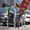 Lily Collins feeding the parking meter in Beverly Hills - 454 x 523