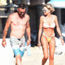 Tina Louise in a bikini with Brian Austin Green at the beach in Los Angeles - 454 x 576