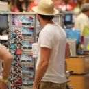 They like the taste of him! Leonardo DiCaprio shows off his mosquito-bitten legs as he stocks up on low-calorie drinks