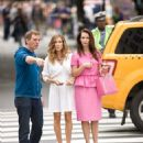 (L-r) Writer-producer-director MICHAEL PATRICK KING, SARAH JESSICA PARKER and KRISTIN DAVIS on the set of New Line Cinema's comedy 'SEX AND THE CITY 2,' a Warner Bros. Pictures release. Photo by Craig Blankenhorn