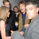 Taylor Swift, Calvin Harris and Sir Mick Jagger attend the Universal Music Brits party hosted by Bacardi at The Soho House Pop-Up on February 25, 2015 in London, England. - 454 x 301