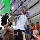 Tyga performs during DAYLIGHT Beach Club's grand opening weekend at the Mandalay Bay Resort and Casino on March 26, 2017 in Las Vegas, Nevada - 454 x 366
