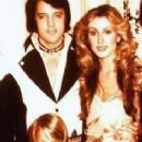 Elvis Presley and Linda Thompson with Lisa Marie - 236 x 483