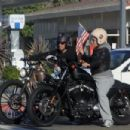 Pink seems to be enjoying herself on a motorcycle ride with husband Carey Hart in Malibu. Pink, who recently gave birth to a daughter named Willow Sage, was leaving a park after playing a game of baseball with Carey
