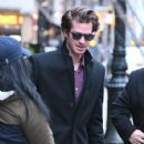 Andrew Garfield greets a fan as he leaves a downtown hotel in New York City, New York on January 10, 2017