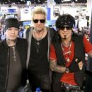 DJ Ashba, James Michael and Nikki Sixx attend day 3 of the 2016 NAMM Show at the Anaheim Convention Center on January 23, 2016 in Anaheim, California. - 454 x 312