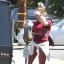 Hilary Duff – Pays the parking meter in LA