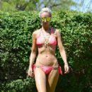 Lady Victoria Hervey in Bikini on the pool in Indio - 454 x 529