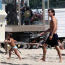 Scott Disick and his son Mason Disick enjoyed a day at the beach in Miami, Florida on August 4, 2012