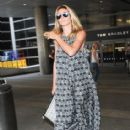 Heidi Klum and her boyfriend touch down at LAX airport in Los Angeles, Califronia on July 31, 2016 - 414 x 600