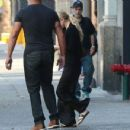Mary-Kate Olsen stays hidden behind her bodyguard as she steps out on August 29, 2014 in New York City