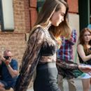Cara Delevigne is seen sporting lace during a walk on July 22, 2015