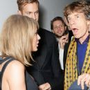 Taylor Swift, Calvin Harris and Sir Mick Jagger attend the Universal Music Brits party hosted by Bacardi at The Soho House Pop-Up on February 25, 2015 in London, England. - 454 x 620