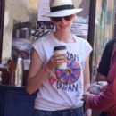 Anne Hathaway makes a quick stop for coffee while out and about in Los Angeles on July 23, 2013
