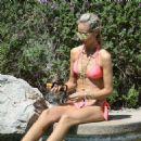 Lady Victoria Hervey in Bikini on the pool in Indio - 454 x 477