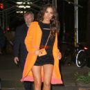 Olivia Culpo in Shorts and Orange Coat – Out in New York City