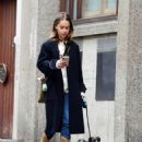 Emilia Clarke – Walking her dog as they visiting the park in London