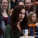 Megan Fox plays April O'Neal in 'Teenage Mutant Ninja Turtles' in New York City's Times Square on July 22, 2013