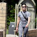 Lucy Hale – Enjoys a morning walk with her dog Elvis in Los Angeles