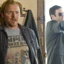 Simon Pegg as Graeme Willy and Bill Hader as Haggard in Universal Pictures' Paul.