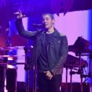 Nick Jonas performs onstage at Z100's Jingle Ball 2015 at Madison Square Garden on December 11, 2015 in New York City
