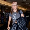 Lucy Lawless is all smiles as she arrives at LAX (Los Angeles International Airport)