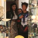 Jaden Smith puts his arms around Kylie Jenner and shows her an item while shopping together at Crystalarium on Tuesday (November 19) in West Hollywood, Calif - 454 x 583