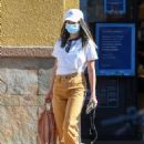 Jamie Chung – Wearing colored jeans as she runs errands in Los Angeles - 454 x 615