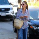 Rebecca Gayheart in flared denim pants out in Los Angeles