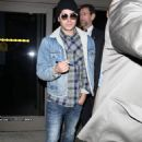 Zac Efron arriving @ LAX. His left hand had antiseptic cotton on it at The Lucky  One