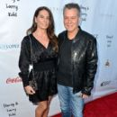 Janie Liszewski and Eddie Van Halen attend the George Lopez Foundation 10th Anniversary Celebration Party at Baltaire on April 30, 2017 in Los Angeles, California - 400 x 600