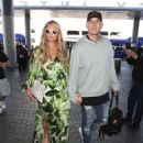 Paris Hilton and Chris Zylka are seen at LAX.NON EXCLUSIVE June 08, 2018 - 454 x 600