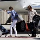 Julia Roberts at Van Nuys airport in Los Angeles, CA with her were hubby Danny Moder and children Hazel and Phinnaeus Moder (July 7) - 454 x 331