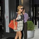 preggers Beyonce shows off her growing belly in a cute ruffled dress as she leaves the Gansevoort hotel in NYC. 09/30/2011