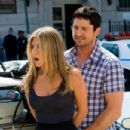 Jennifer Aniston and Gerard Butler star in Columbia Pictures' action comedy THE BOUNTY HUNTER. Photo By: Barry Wetcher SMPSP. ©2010 Columbia TriStar Marketing Group, Inc.  All Rights Reserved.