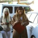 Blac Chyna and Kim Kardashian Shopping at Neiman Marcus in the Topanga Canyon Mall in Los Angeles - December 13, 2013