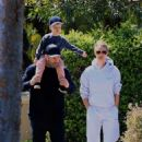 Rosie Huntington-Whiteley – Out for a walk with a family in Beverly Hills