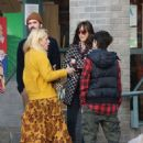 Dakota Johnson meets up with Busy Philipps at Larchmont Village in Los Angeles