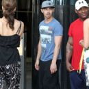 Joe Jonas chatted with a female friend as he departed his hotel in Sydney, April 2. Joe was in Australia to attend the opening of Marquee, The Star