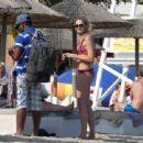 Stephanie Pratt in Red Bikini on the beach in Mykonos