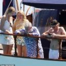 Queen's Roger Taylor uses a pole and shoots an AIRGUN at jellyfish whilst on a boat ride with his wife and children during sun-soaked holiday in Spain, 31 May 2019 - 454 x 371